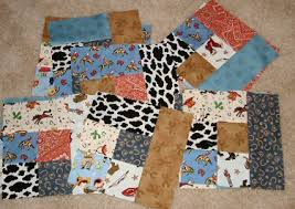 Yippie Ki-Ay Cowboy Quilt | StacySews & I realized that I won't have enough backing material to cover the entire  quilt so I'm going to have to piece something together. Drat! Adamdwight.com