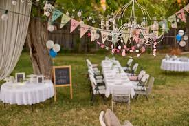 backyard decoration idea with hanging chandelier for birthday party