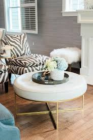 black and white zebra slipper chairs with round white leather tufted ottoman