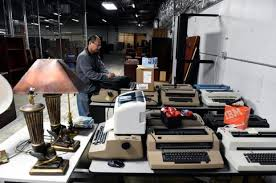 office supplies denver. Yudi Anggraito, A Merchandising Manager For Office Liquidators, Puts Prices On Furniture In The Supplies Denver