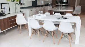 high gloss extending dining table and eames chairs