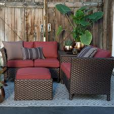 resin wicker outdoor conversation set with red cushions