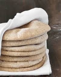 a stack of homemade whole wheat pita bread