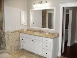 Traditional White Bathrooms Traditional Gray Bathroom A White Furniture Style Vanity Is Topped