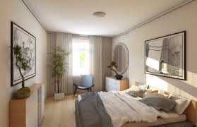 a simple bedroom with plain white walls and ceiling the floor bed and cabinets