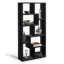 furniture high black wooden bookcase with random size shelves placed on the white floor