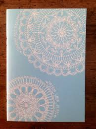 hand decorated sky blue cover sketchbook by swirlypaperart