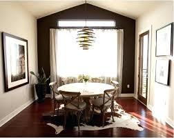 faux animal rug small dining space with black white print and rustic zebra skin australia