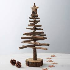 Prev of Page Use twigs to make little Christmas trees that you can place  around your home. You can even hang little rustic ornaments on them as well!