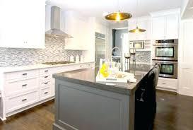 kitchen gray island wall cabinets pendant lights handles white particle board faucet crosley cambridge black granite