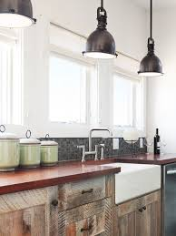 warehouse lighting in kitchen with rustic cabinets