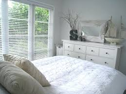Ikea White Bed A Medium Sized Bedroom With A White Bed For Two With ...