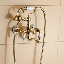 luxury wall mount gold finish rotating clawfoot bathtub faucet with handheld shower head