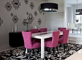 modern dining room with purple chairs drum pendant light and large patterned area rug