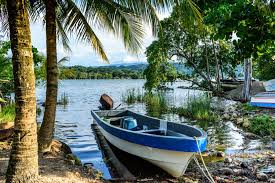 livingston roatan. boats in late afternoon light on rio dulce, livingston, guatemala livingston roatan