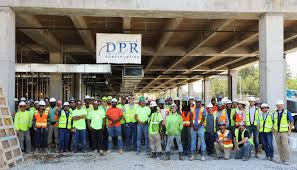 dpr s serta simmons project team celebrates the milestone placement of the last structural beam for the company s new headquarters