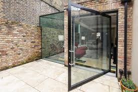 a huge door close to 3 metres width can create a true glass wall when closed and an impressive door when open