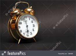 house living nice golden alarm clock on dark background with copy space