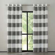 Sophisticated modern curtain panels alternating horizontal stripes of ivory  cotton and lustrous grey cotton sateen hang
