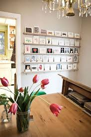 smart ideas to display unframed photos and postcards on wall