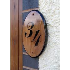 wooden slice house number sign