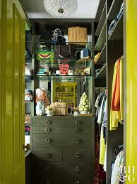 the pieces provide plentiful storage both inside drawers and on top this small walk in closet design incorporates a
