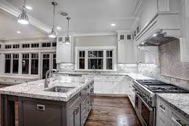 off white kitchen cabinets with dark granite countertops