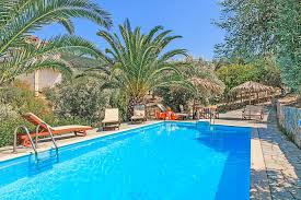 palm trees around swimming pools round designs
