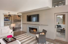contemporary home remodel with fireplace and spotlights