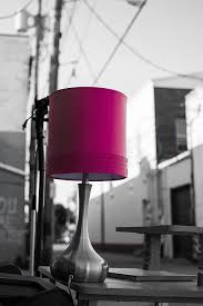 a pink lamp that was discarded in a back alley in downtown stillwater oklahoma