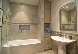 chic bathroom tile design with bathtub shower combo and pedestla sink also bathroom cabinets