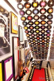 record feature wall in under stair playroom on wall art using vinyl records with diy with style how to cover a wall in vinyl records damage free