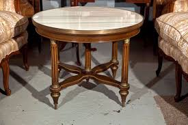 french empire style mahogany coffee table circa 1940s the white circular marble with bronze