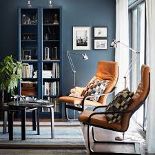 ikea retro furniture. a small livingroom furnished with two armchairs naturalcoloured leather cushions and black ikea retro furniture