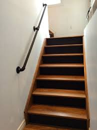 gas pipe railing, walnut stairs, black risers More