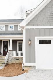 grey siding paint color is gauntlet gray sherwin williams and white trim paint color is snowbound by sherwin williams hale navy shutters