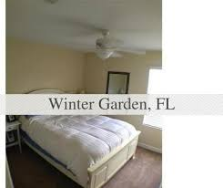 rentals in winter garden fl. townhouse- end unit with side views looking onto large greenbelt area. rentals in winter garden fl