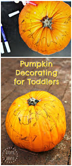 toddler pumpkin decorating for