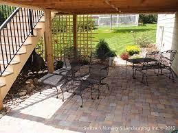 paver patio under deck with retaining
