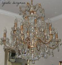 for every single crystal on this chandelier there were two or three teeny tiny brass pieces like the wires etc thank goodness she kept those and worked