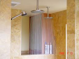 sophisticated stainless steel ceiling rain shower heads also marble wall tiles as well as small space luxury bathroom decors ideas