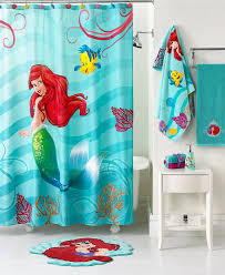 attractive mermaid shower curtain motif combined with blue color mermaid mat design and blue sea towlel in bright white kids bathroom