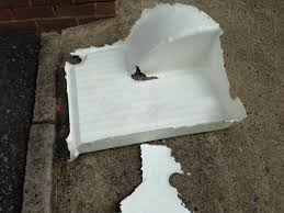 poor quality fibreglass coating removed demonstrating no adhesion to plastic shower tray