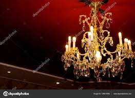 beautiful crystal chandelier on black ceiling stock photo