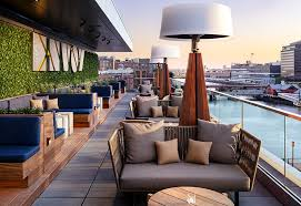 envoy hotel s rooftop lounge offering creative cocktails small plates and incredible harbor side views