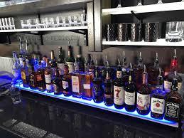 back bar lighting. 2 tier led lighted bar shelving w blue lighting back