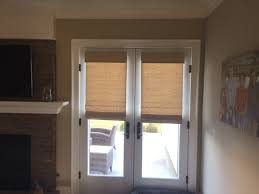 wood roman shades. Woven Wood Roman Shades On A French Door In Family Room.