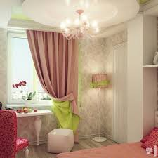 bedroom chandeliers lamp on the ceiling and pink green fabric curtain on the hook also