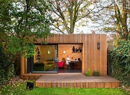 outside office shed. this stunning garden office with bike shed was built for a freelance photographer who required space plus ample storage all his kit outside