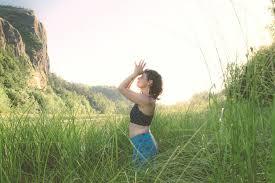 beautiful yoga instructor outdoors in columbia river gorge nature area portland oregon
